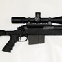 The sleek Armalite 30M in 338 Lapua with matching Velocity 1000 reticle in a Nightforce 5.5-22x56 scope.